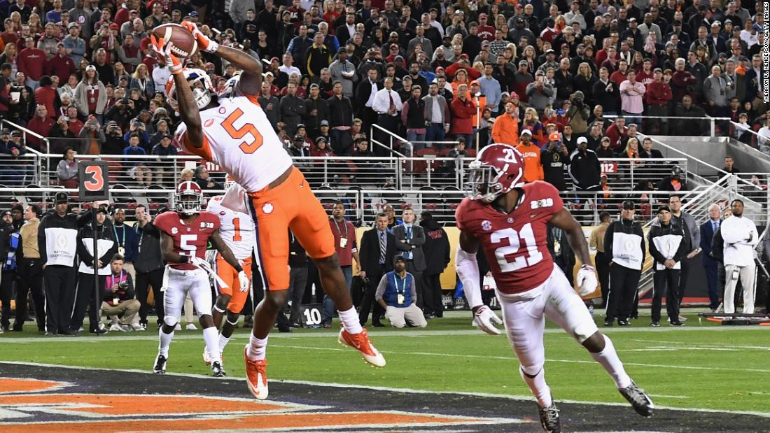 Tee Higgins catches a third-quarter touchdown pass for Clemson. It was the final score of the game.