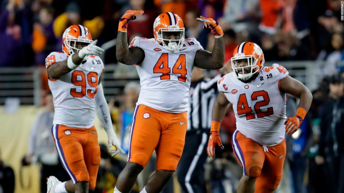 Clemson's Nyles Pinckney, center, celebrates after stopping a fake field goal by Alabama during the second half.