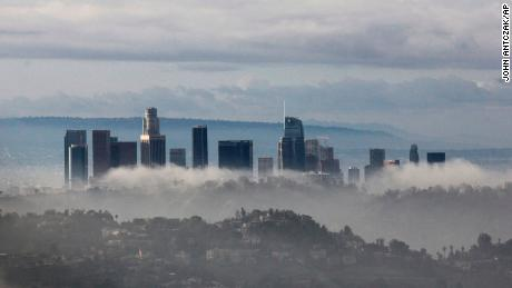 Mist rises in Los Angeles Sunday after a storm Saturday night.