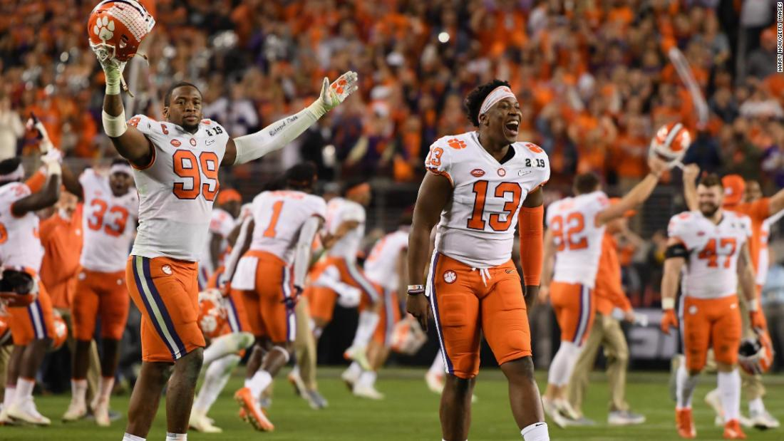 Clemson players, including Clelin Ferrell (No. 99) and Hunter Renfrow (No. 13), run onto the field to celebrate.