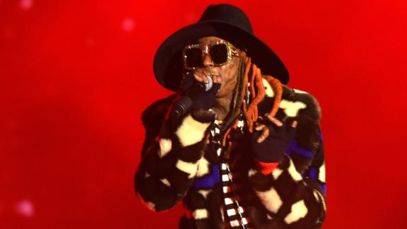 Lil Wayne's colorful get-up attracts attention during Monday night's halftime show in San Francisco.