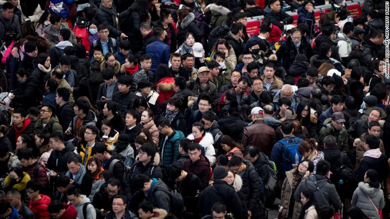 Passengers gather in the waiting hall at Hongqiao Railway Station ahead of the Lunar New Year holidays in 2018. The country's population is expected to decline by almost 200 million by mid-century.