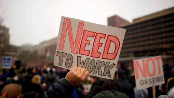 """PHILADELPHIA, PA - JANUARY 08:  Fred Jennings, 67, holds a placard stating """"NEED TO WORK"""" while gathering with area elected officials and furloughed federal workers at a rally in front of Independence Hall on January 8, 2019 in Philadelphia, Pennsylvania.  The government shutdown, now lasting 18 days, marks the second longest United States in history, affecting about 800,000 federal employees.  (Photo by Mark Makela/Getty Images)"""