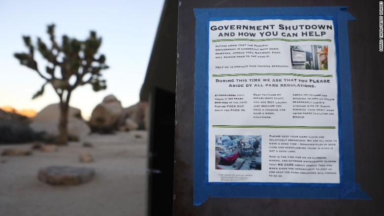 A sign placed by a volunteer is taped to a restroom door at Joshua Tree National Park on January 4, 2019 in Joshua Tree National Park, California.
