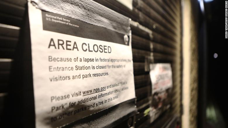 A 'closed' sign is posted a shuttered entrance station at Joshua Tree National Park in California on January 3.