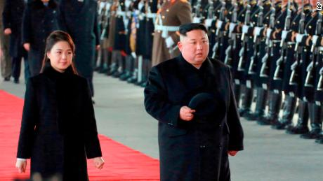 "In this Monday, Jan. 7, 2019, photo provided on Tuesday, Jan. 8, 2019 by the North Korean government, North Korean leader Kim Jong Un walks with his wife Ri Sol Ju at Pyongyang Station in Pyongyang, North Korea, before leaving for China. Kim left for China for a four-day trip, the North's state media reported Tuesday, amid speculation that he may attempt to coordinate his positions with Beijing ahead of his likely summit with U.S. President Donald Trump. Independent journalists were not given access to cover the event depicted in this image distributed by the North Korean government. The content of this image is as provided and cannot be independently verified. Korean language watermark on image as provided by source reads: ""KCNA"" which is the abbreviation for Korean Central News Agency. (Korean Central News Agency/Korea News Service via AP)"