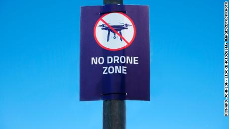 "A ""no drone zone"" poster is seen at Gatwick Airport, which was brought to a halt for 36 hours in December following drone sightings."