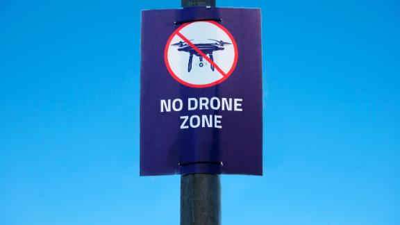 Drone in sky sign at Gatwick Airport flying not allowed or permitted air zone uk