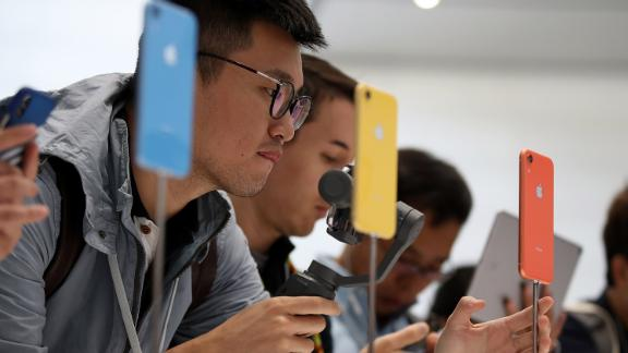Visitors inspecting the new iPhone XR at an Apple special event in Cupertino in September.