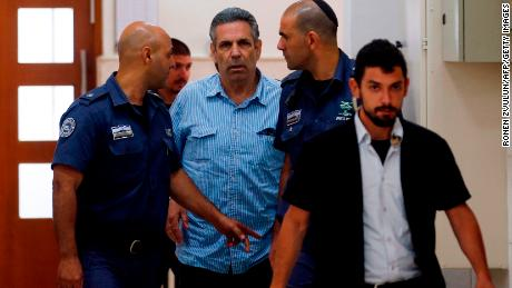 Former Israeli minister Gonen Segev, center, arrives at court in Jerusalem on July 5, 2018.