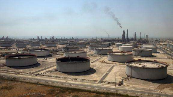 FILE: Crude oil storage tanks at the Juaymah Tank Farm in Saudi Aramco's Ras Tanura oil refinery and oil terminal in Ras Tanura, Saudi Arabia, on Monday, Oct. 1, 2018. All eyes are on this weekends G-20 summit in Argentina, where Russias Vladimir Putin and Saudi Arabias Mohammed bin Salman are likely to discuss how to coordinate oil policy. The nations are in talks over the timing of any reduction in supply, Reuters reported Thursday, a week before producers are due to meet in Vienna to discuss the market and a possible cut in 2019. Photographer: Simon Dawson/Bloomberg via Getty Images