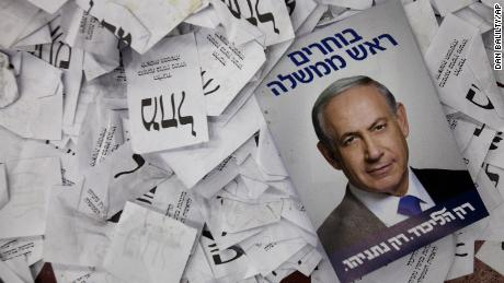 An election campaign poster for Israeli Prime Minister Benjamin Netanyahu is seen at his party's election headquarters.