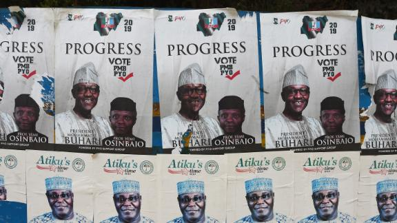 A picture shows campaign posters for Nigeria