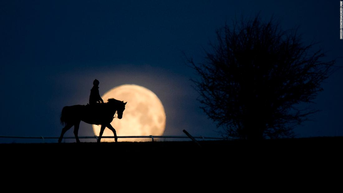 "Multi award-winning snapper Edward Whitaker earned horse racing's photograph of the year award with this stunning image of a rare blue supermoon in Lambourn, Berkshire in January 2018. ""I knew a spot where the angle was just right,"" he says. Here he talks CNN Sport through seven of his favorite images."