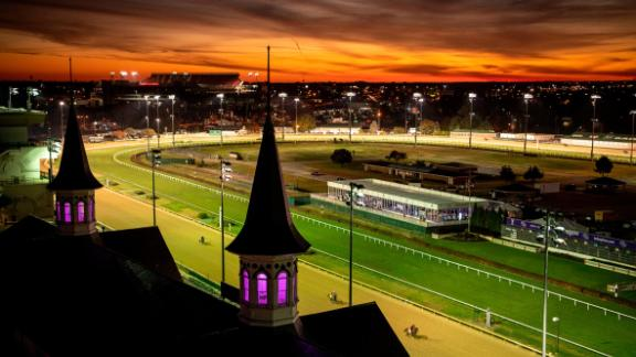 "This color-filled image of Churchill Downs is another Whitaker favorite. ""I knew there was this fire exit up to a door that opened onto the roof so I went up there and caught this great dawn. There was a cold front coming in, so I knew there would be some very dramatic reds and yellows in the sky. And now they light up the iconic spires with purple light, so the colors are unbelievable. It's so American and over the top."""