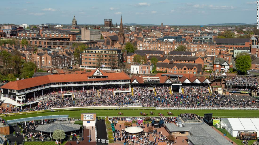 "Whitaker conquered his fears and rode up in the TV crane to capture this image of the city of Chester and the racecourse. ""This is the scariest picture I've ever taken.  You go up on this wobbly plank with a safety harness clipped to a metal frame. I was absolutely terrified but the view was amazing, the light was just right and I got this great scene of Chester with the action on the racecourse."""