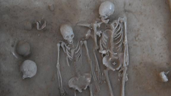 The man and woman died and were buried together -- but what killed them?