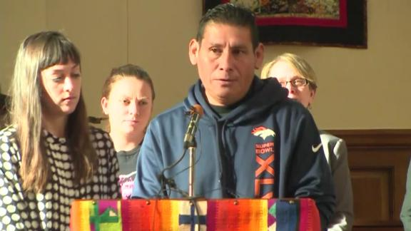Miguel Ramirez Valiente speaks to reporters from the pulpit at All Souls Unitarian Universalist Church in Colorado Springs, Colorado, where he says he