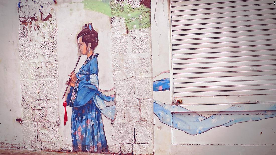 "Street art in Chinatown in Mauritius. The area is now mostly a center for trade rather than living. It's a problem that is being seen elsewhere in the world from Washington and San Francisco's Chinatown to Cuba, in Havana's Barrio Chino, one of the oldest and largest Chinatown districts in Latin America that now famously contains very little Chinese, according to the <a href=""http://www.Visitcuba.Com/2012/10/havanas-chinatown-barrio-chino-de-la-habana/"" target=""_blank"">Visit Cuba</a> website."