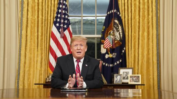 WASHINGTON, DC - JANUARY 08: U.S. President Donald Trump speaks to the nation in his first-prime address from the Oval Office of the White House on January 8, 2019 in Washington, DC. A partial shutdown of the federal government has gone on for 17 days following the president's demand for $5.7 billion for a border wall while Democrats have refused.  (Photo by Carlos Barria-Pool/Getty Images)