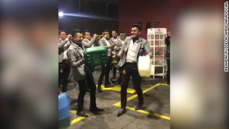 A band in the Mexican state of Michoacan posted a video of their performance at a gas station during fuel shortage online.