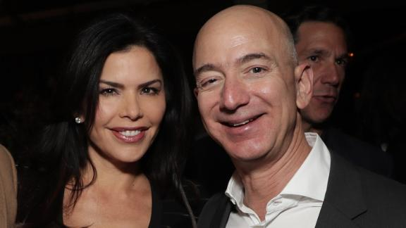 """LOS ANGELES, CA - DECEMBER 03:  WME's Patrick Whitesell, Lauren Sanchez and Amazon CEO Jeff Bezos attend Jeff Bezos and Matt Damon's """"Manchester By The Sea"""" Holiday Party on December 3, 2016 in Los Angeles, California.  (Photo by Todd Williamson/Getty Images for Amazon Studios)"""