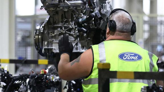 A worker removes a Ford Transit van engine from the conveyor at the Ford Motor Co.s engine assembly plant in Dagenham, U.K., on Monday, Oct. 9, 2017. Chief Executive Officer Jim Hackett pledged accelerated work on green and driverless vehicles, more partnerships and acquisitions, a focus on the trucks and SUVs buyers want, and improved operational fitness. Photographer: Luke MacGregor/Bloomberg via Getty Images