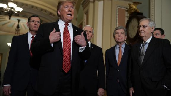 President Donald Trump speaks to members of the press as Sen. John Barrasso of Wyoming, Vice President Mike Pence, Sen. Roy Blunt of Missouri and Senate Majority Leader Sen. Mitch McConnell listen at the US Capitol after the weekly Republican Senate policy luncheon in January.