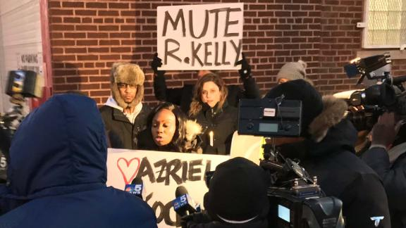 Protesters outside R. Kelly's studio in Chicago call for a boycott of his music.