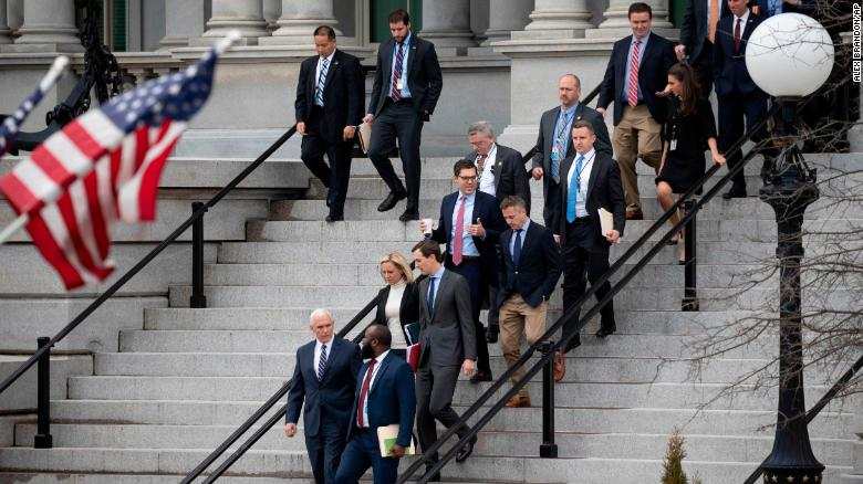 Vice President Mike Pence and other White House staffers leave shutdown negotiations.