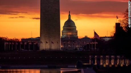 The Capitol and Washington Monument are seen at dawn as the partial government shutdown lurches into a third week with President Donald Trump standing firm in his border wall funding demands, in Washington, Monday, Jan. 7, 2019. After no weekend breakthrough to end a prolonged shutdown, newly empowered House Democrats are planning to step up pressure on Trump and Republican lawmakers to reopen the government. (AP Photo/J. Scott Applewhite)