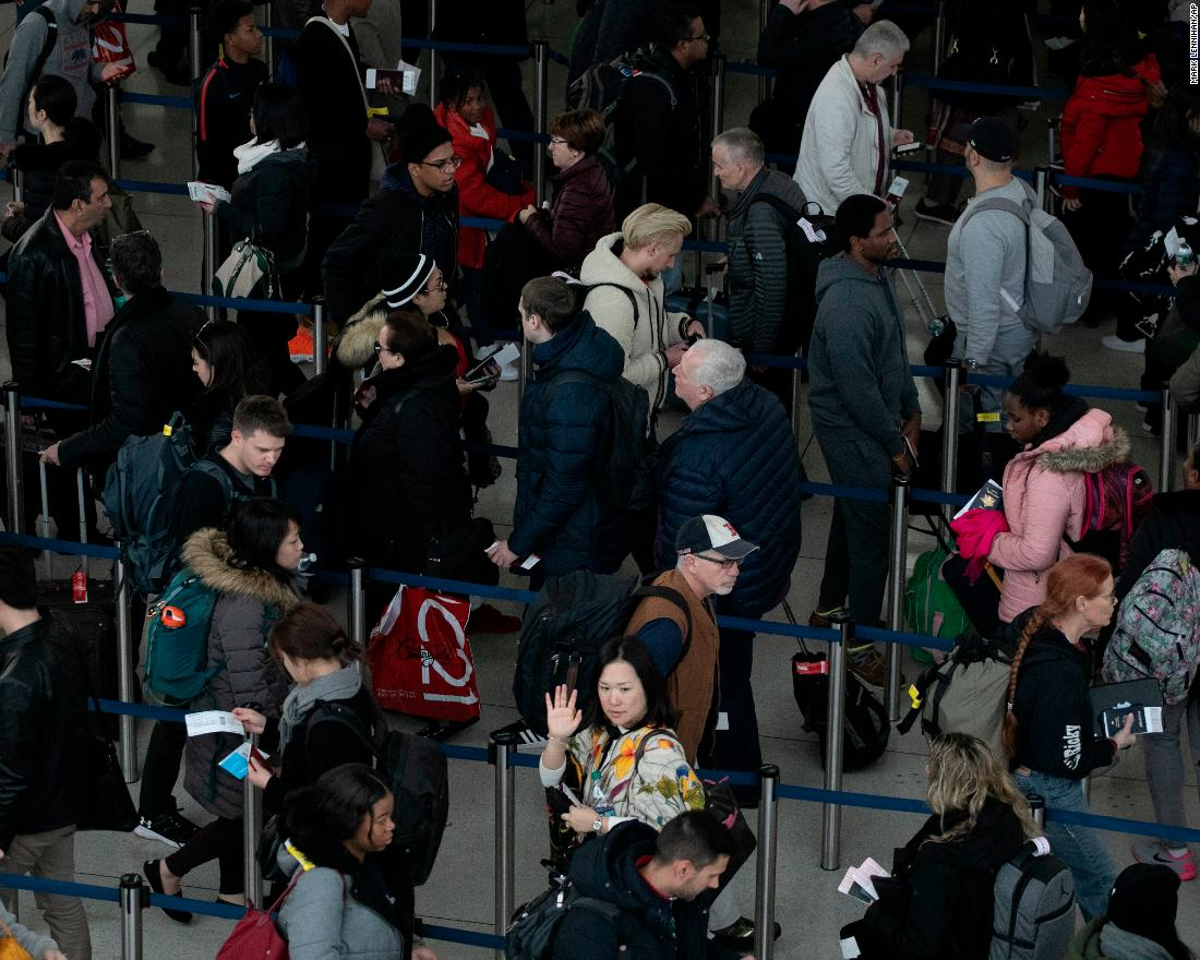 Passengers wait in line at New York's John F. Kennedy International Airport on Monday, January 7.