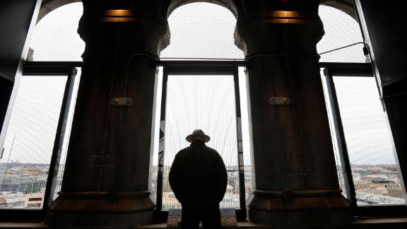A National Park Service ranger looks out onto Washington from the Trump International Hotel