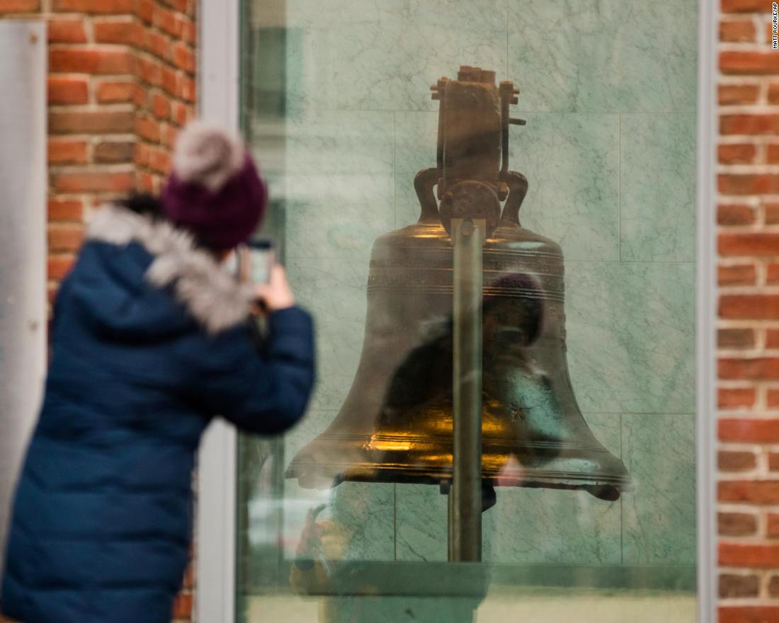 A tourist in Philadelphia takes a picture through a window of the closed building housing the Liberty Bell on January 8.