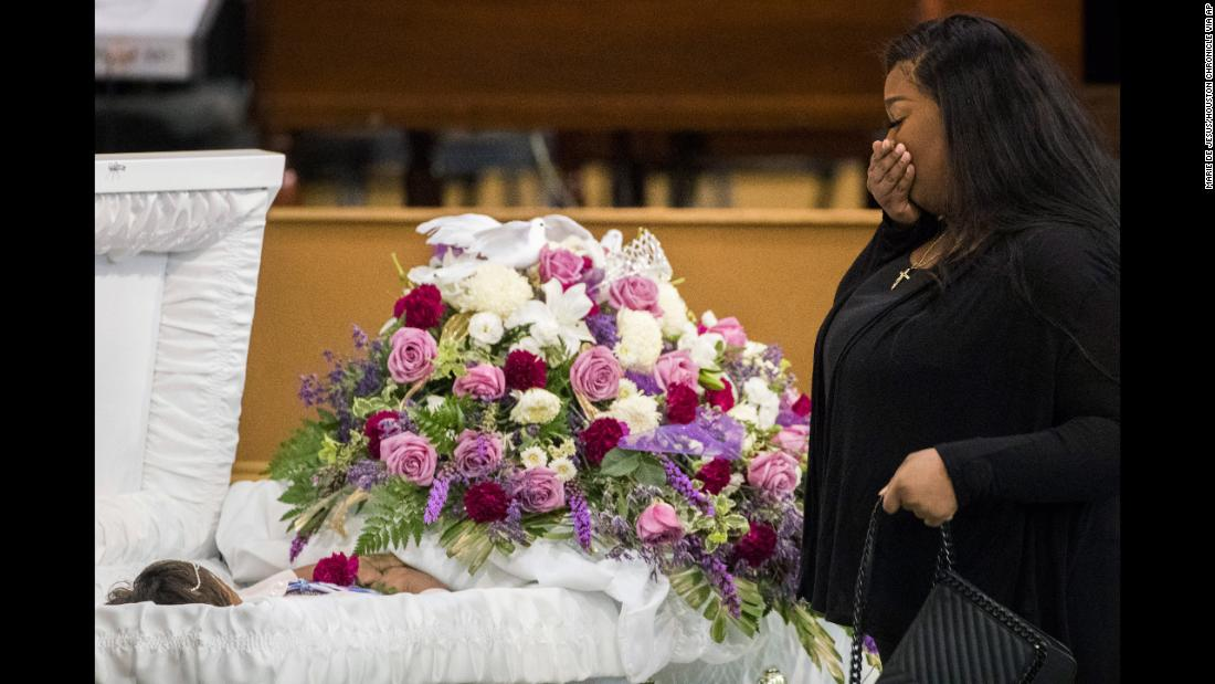 A mourner approaches the casket of Jazmine Barnes during a viewing ceremony before the memorial services on Tuesday, January 8, at the Community of Faith Church in Houston. Barnes was fatally shot on December 30 while in a car with her family.