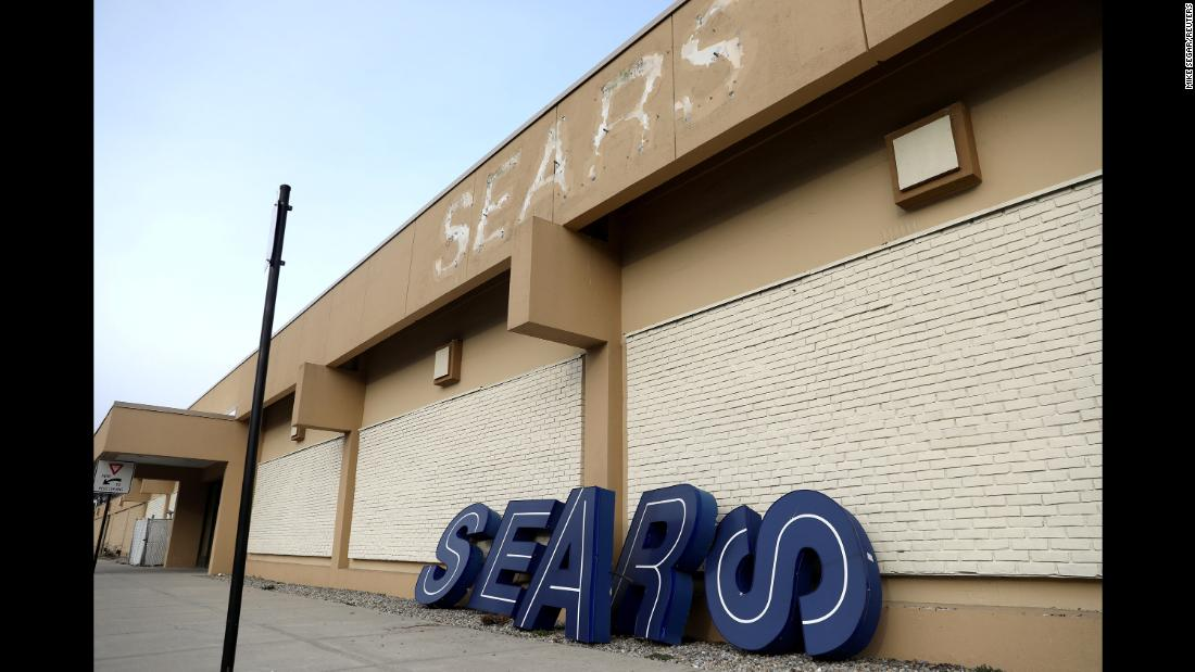 Letters from a dismantled Sears sign lean against a store in Nanuet, New York, on Monday, January 7, one day after it closed along with many other locations of the department store chain.