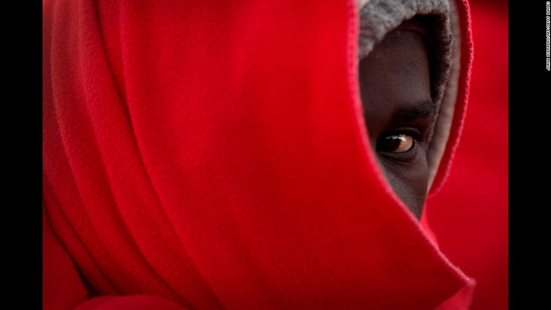 A migrant keeps warm with a Red Cross blanket upon arrival in Malaga, Spain, on Sunday, January 6. An inflatable boat carrying 185 migrants was rescued by the Spanish coast guard.