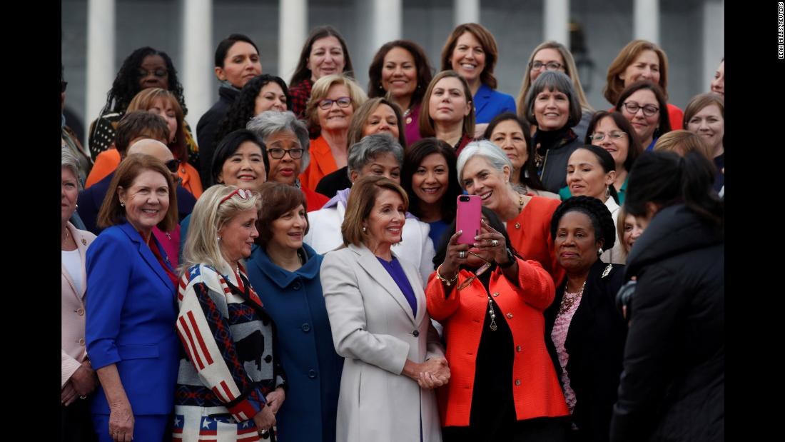 House Speaker Nancy Pelosi poses for a selfie during a photo opportunity with House Democratic women on Capitol Hill on Friday, January 4.