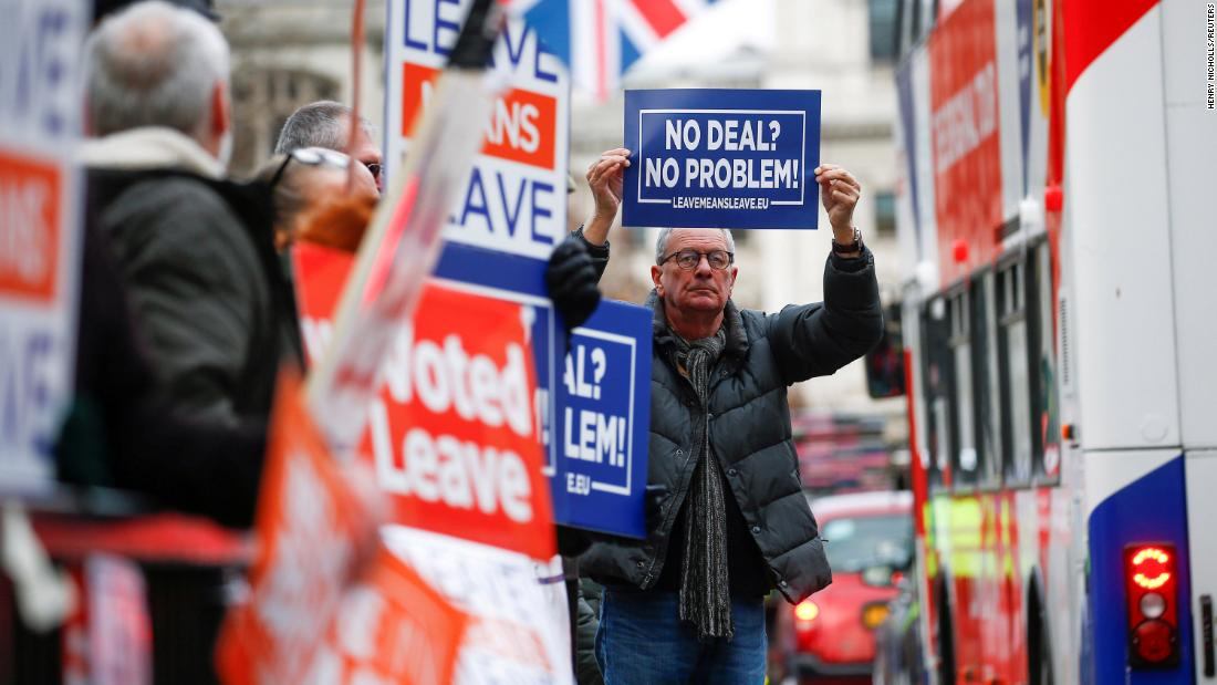 Pro-Brexit demonstrators hold signs outside the Houses of Parliament in London on Wednesday, January 9.