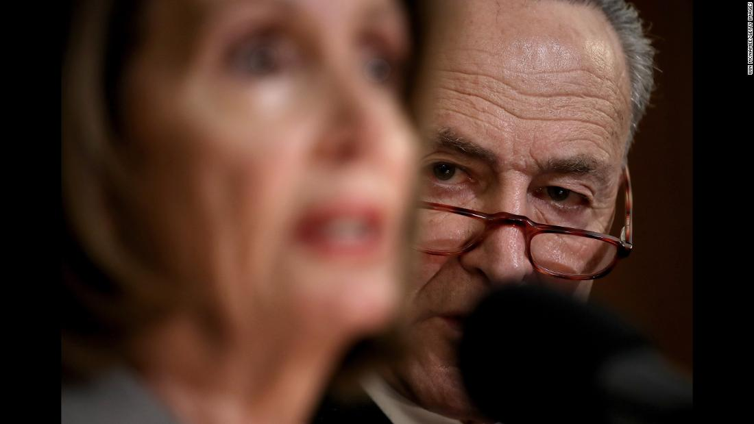 Senate Democratic Leader Chuck Schumer listens as House Speaker Pelosi speaks at an event with federal government employees who asked for an end to the partial shutdown on Wednesday, January 9.