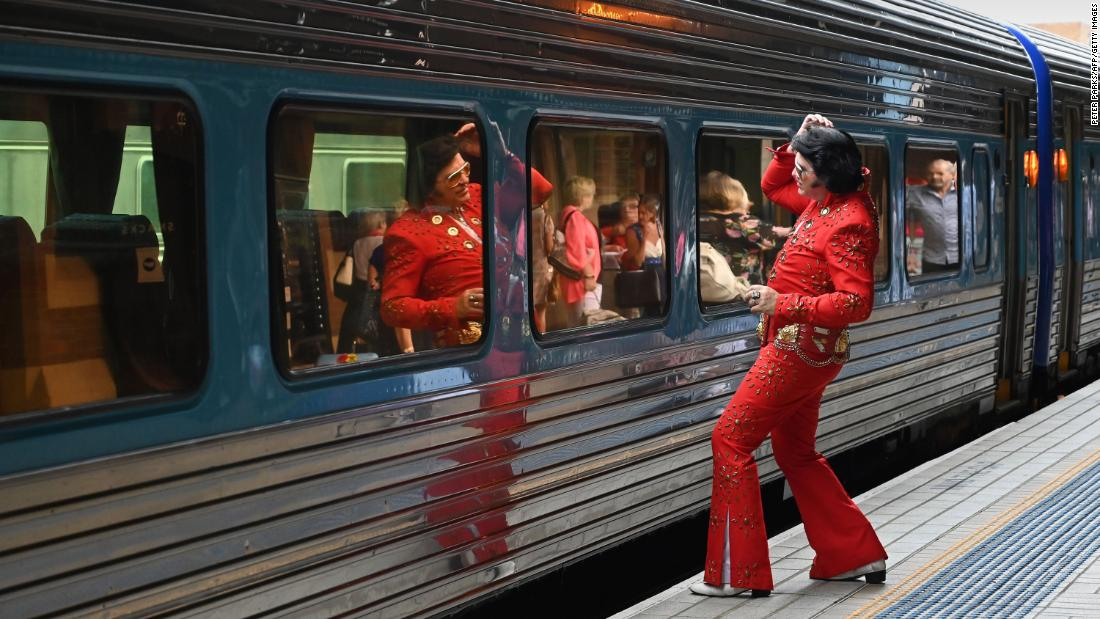 An Elvis fan uses a train window as a mirror before boarding the train to The Parkes Elvis Festival in Sydney, Australia, on Thursday, January 10. Elvis Presley's birthday was January 8. The King of Rock n' Roll would have been 84.