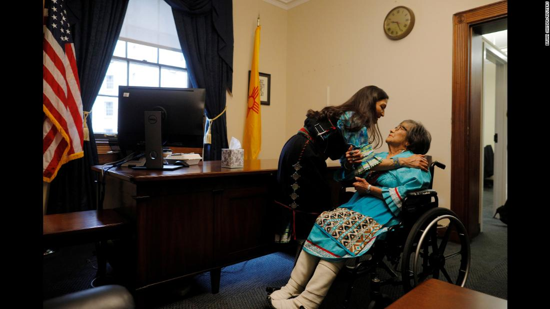 Newly elected Rep. Deb Haaland talks to her mother, Mary, both of whom are wearing traditional Native American attire, in her office at the US Capitol before being sworn in as one of the two first Native American women in the US House of Representatives on Thursday, January 3.