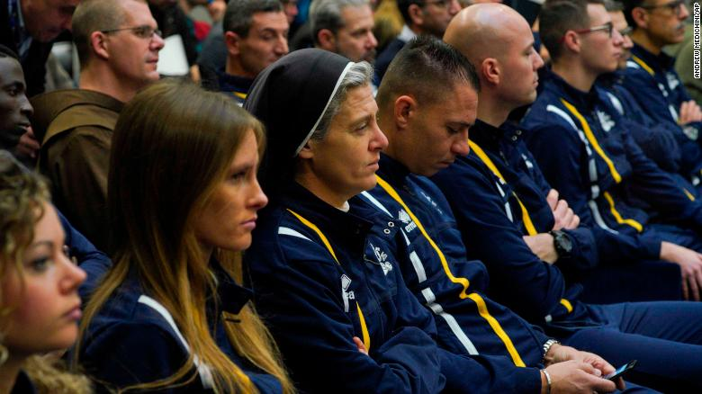 Sister Marie Theo, third from left, sits among other members of the Athletica Vaticana sports team at a press conference on Thursday, January 10.