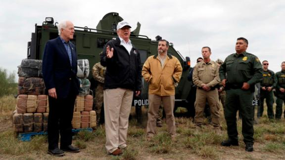 "Trump is joined by US Sens. John Cornyn, left, and Ted Cruz as he visits the US-Mexico border near Mission, Texas, on Thursday, January 10. Trump, surrounded by border patrol agents, said: ""We need security. We need the kind of backup they want."""