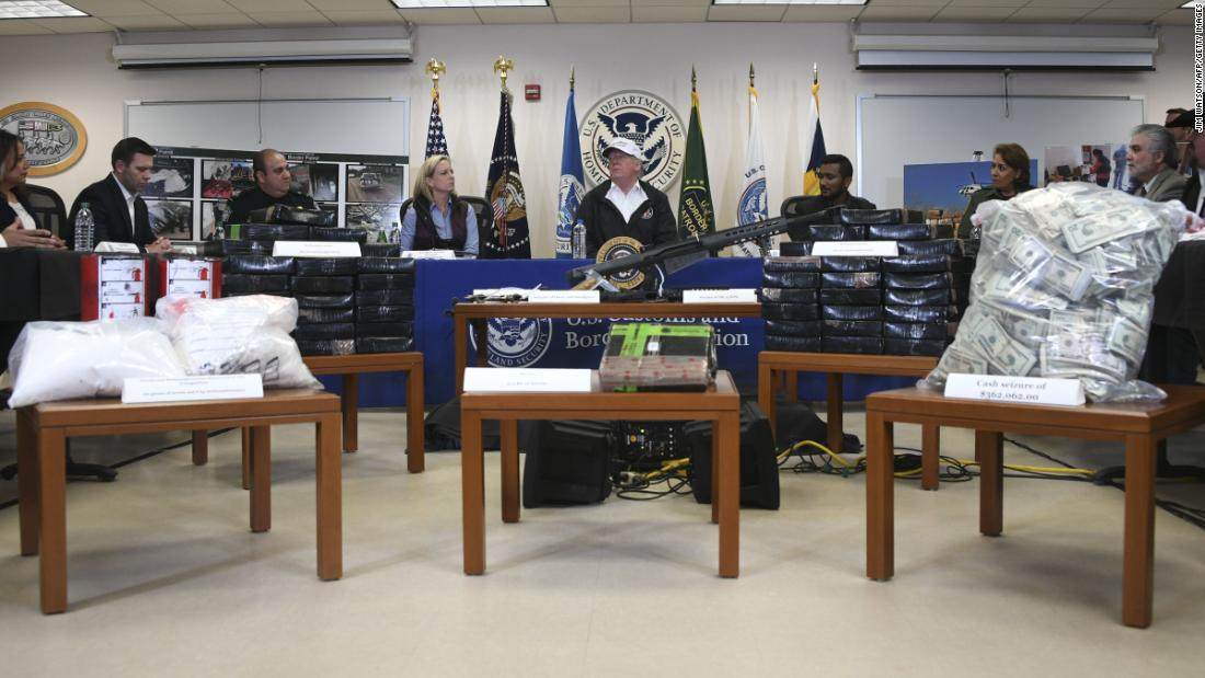 "US President Donald Trump, with Homeland Security Secretary Kirstjen Nielsen, speaks during his visit to US Border Patrol McAllen Station in McAllen, Texas, on Thursday, January 10.  President Trump, who spoke in front of a display of stacks of drugs, guns and cash seized at points of entry, opened the event by praising border patrol agents as ""heroes"" and said they're ""highly respected in our country."""
