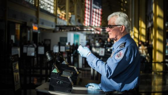 A TSA worker at Reagan National Airport in Arlington, VA, on January 8, 2019. TSA airport security screeners are being forced to work without pay during the government shutdown.