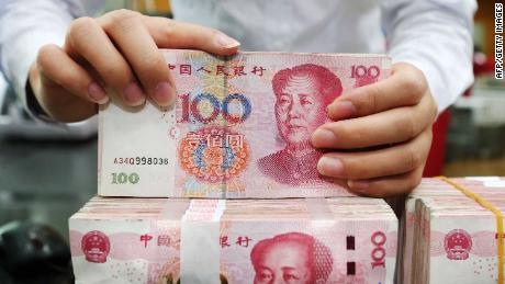 "An employee counts 100-yuan notes at a bank in Nantong in China's eastern Jiangsu province on July 23, 2018. - China on July 23 rejected accusations by US President Donald Trump that it was manipulating the yuan to give its exporters an edge, saying Washington appeared ""bent on provoking a trade war"". (Photo by - / AFP) / China OUT        (Photo credit should read -/AFP/Getty Images)"