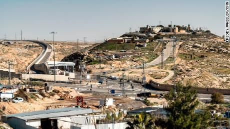 A small Israeli settlement is perched on a hill behind the newly constructed Route 4370.