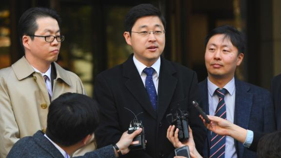 Oh Seung-hun (C), a Jehovah's Witness, speaks to the media after a court's verdict to overturn his conviction on refusing to do mandatory military service, at the supreme court in Seoul on November 1, 2018.