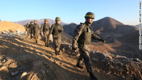South Korean army soldiers leave for the North to inspect the dismantled North Korean guard post in the central section of the inter-Korean border in Cheorwon, South Korea on December 12, 2018.